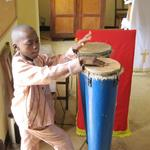 One of the student's children played the drums during the service. About 500 people attended the CLET in Togo graduation service – many were inside and some were outside trying to get a glimpse of the festivities happening inside.
