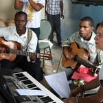 "On Oct. 9, 2011, the congregation ""Amigos de Jesus,"" or ""Friends of Jesus,"" dedicated their new sanctuary in Las Americas, Dominican Republic. Musicians prepare for the special service."